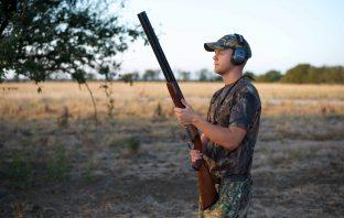 man with shotgun