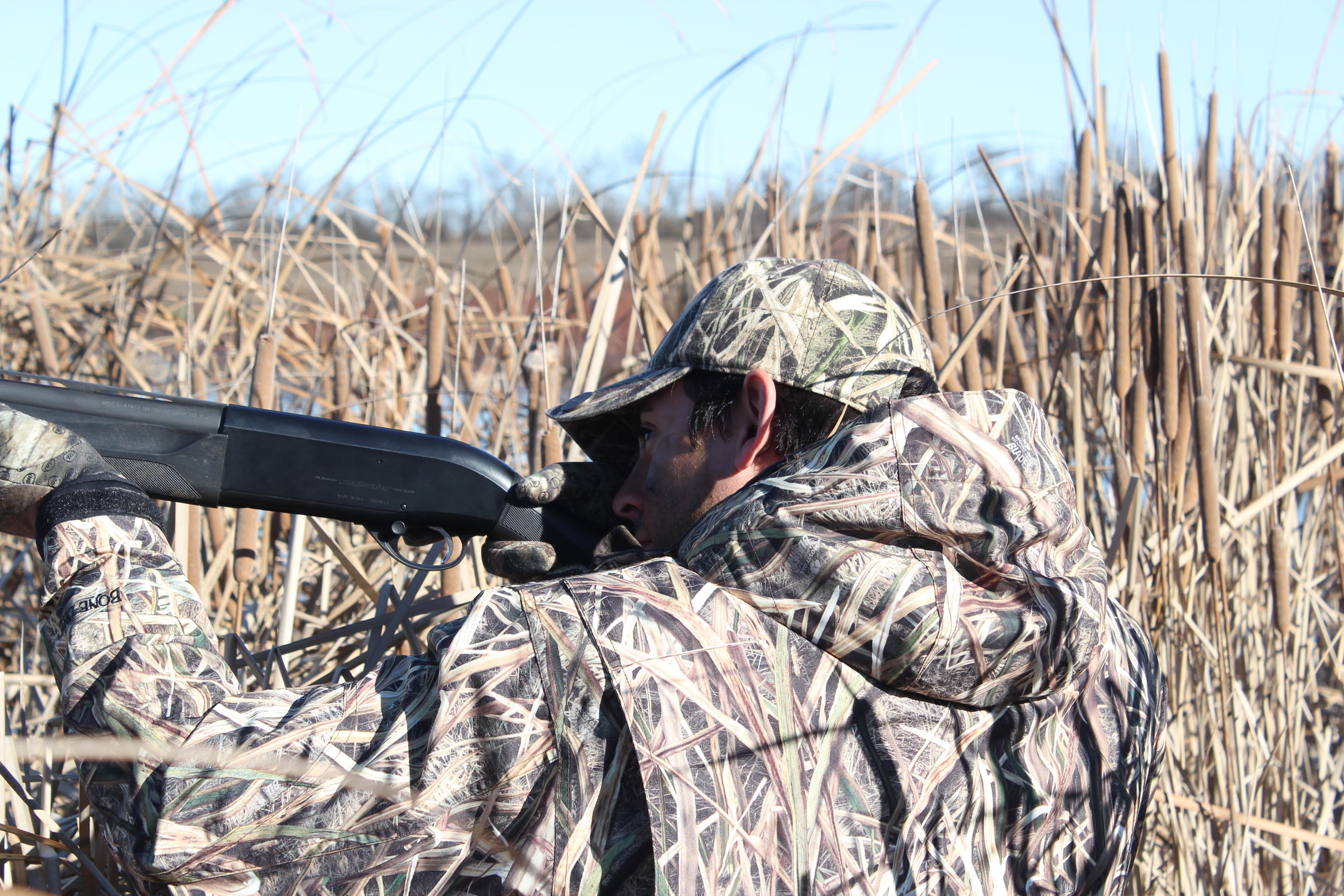 Man hunting ducks in a field